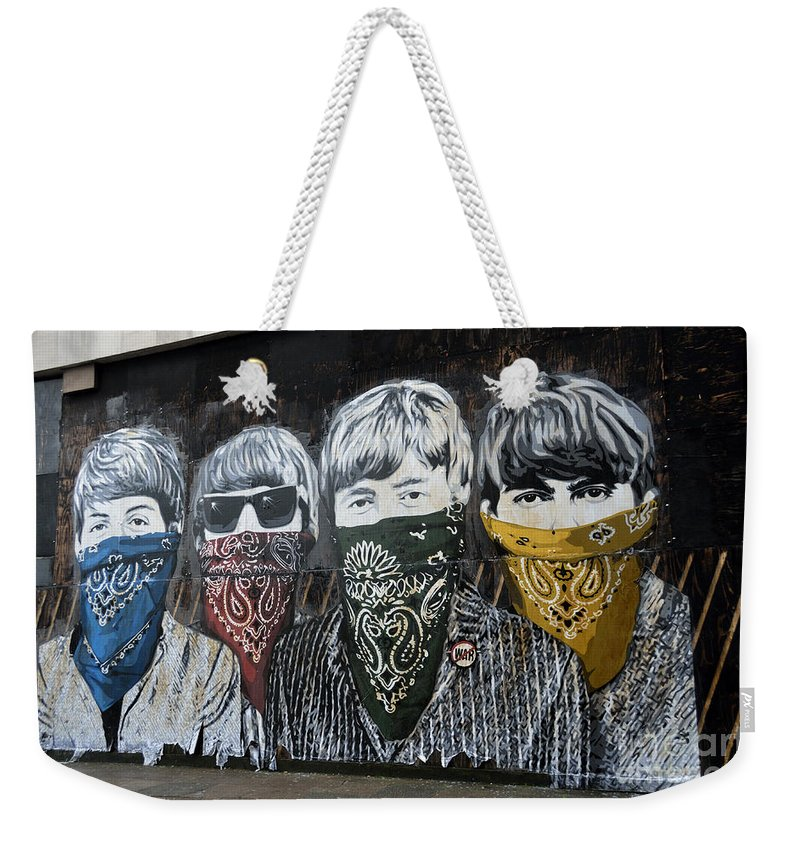 Banksy Weekender Tote Bag featuring the photograph The Beatles wearing face masks street mural by RicardMN Photography