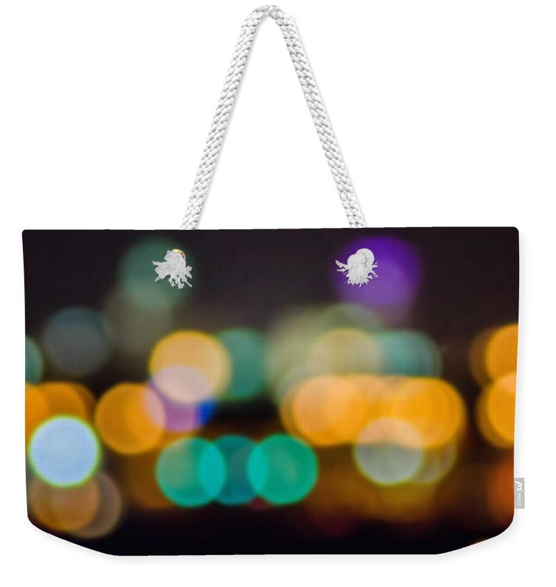 International Weekender Tote Bag featuring the photograph Beautiful Background On Dark Out Of Focus Lights During The Nig by Alex Grichenko