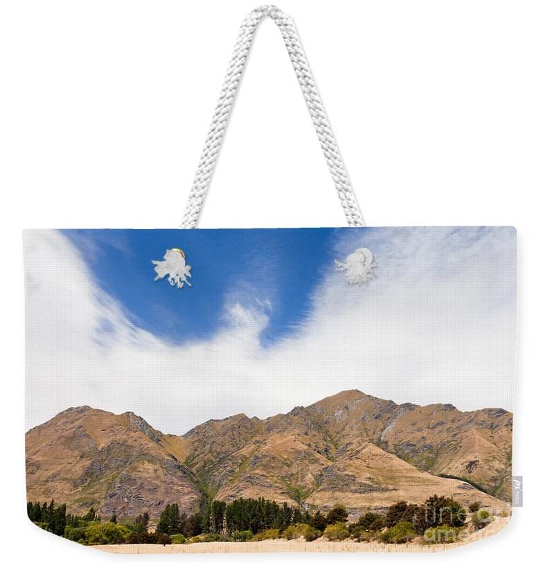 South Island Weekender Tote Bag featuring the photograph Beautiful Roys Peak Near Wanaka In Southern Alps Of New Zealand by Stephan Pietzko