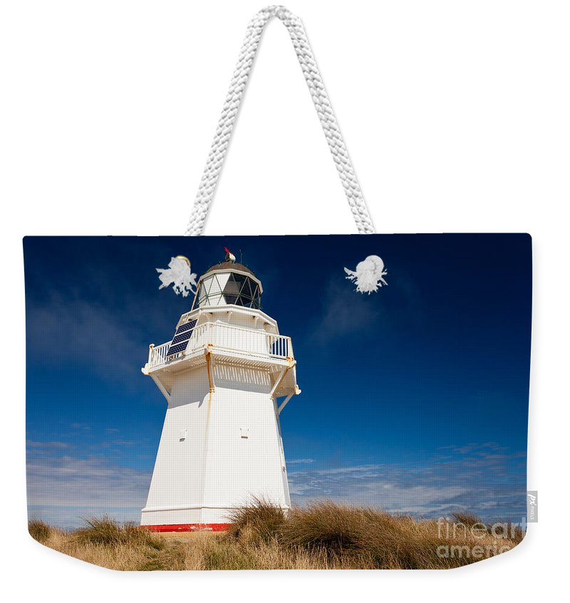 South Island Weekender Tote Bag featuring the photograph Beautiful Waipapa Point Lighthouse The Catlins Nz by Stephan Pietzko