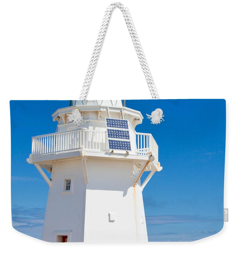 South Island Weekender Tote Bag featuring the photograph Beautiful Wairapa Point Lighthouse The Catlins Nz by Stephan Pietzko