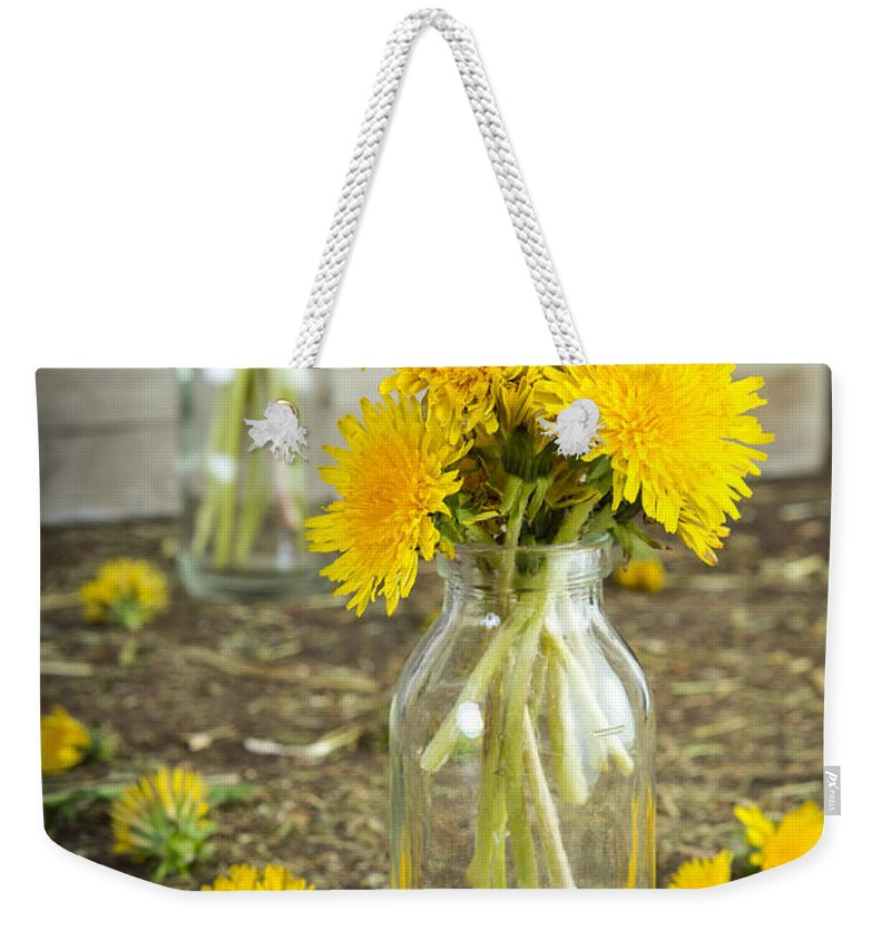 Dandelions Weekender Tote Bag featuring the photograph Beauty Among The Weeds by Edward Fielding