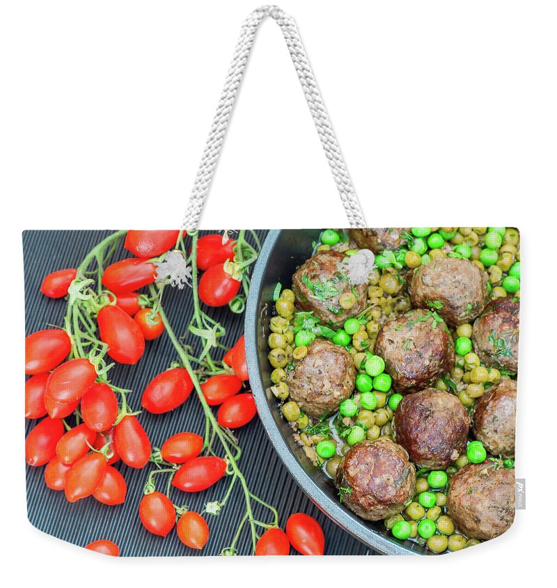 Meatball Weekender Tote Bag featuring the photograph Beef Meatballs With Peas And Lemon by Olga Solan, The Art Photographer