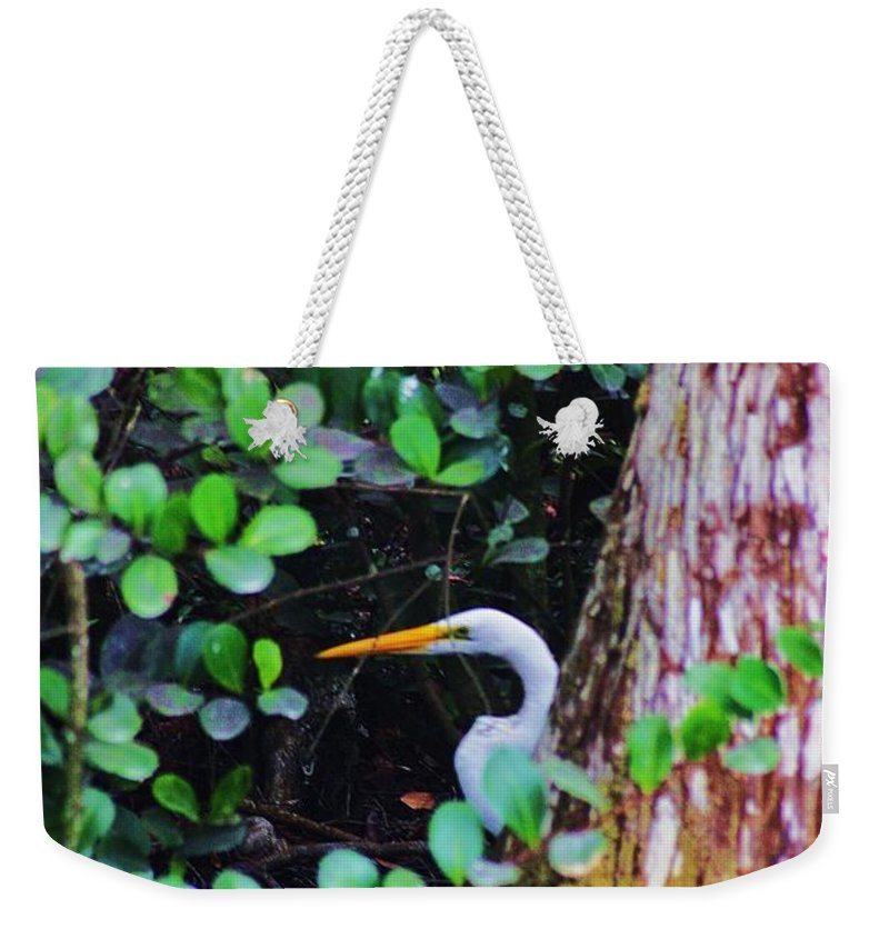 Egret Weekender Tote Bag featuring the photograph Behind The Tree by Chuck Hicks