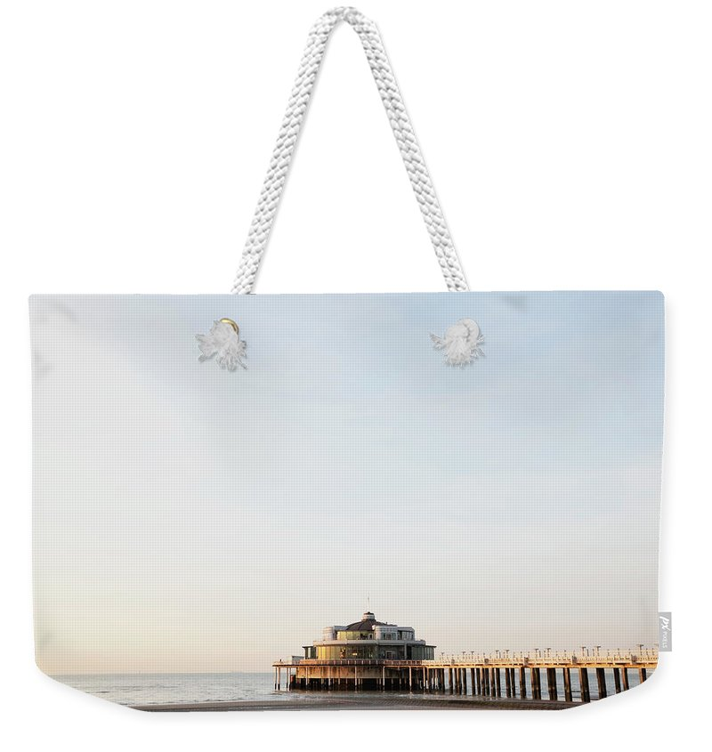 Tranquility Weekender Tote Bag featuring the photograph Belgium, Blankenberge, View Of Pier At by Westend61