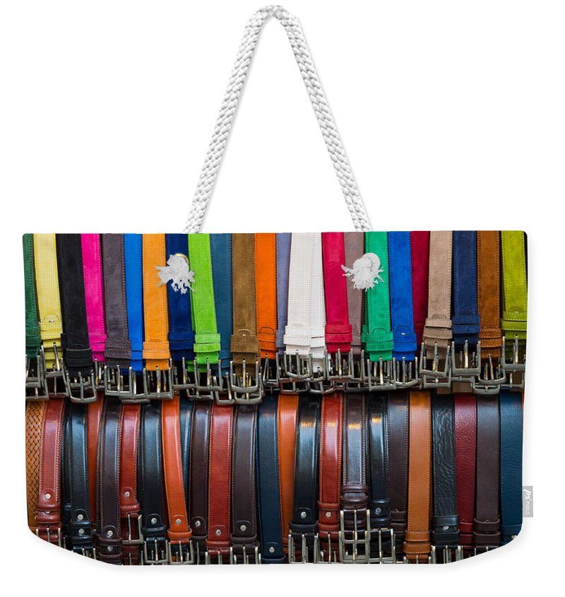 Europe Weekender Tote Bag featuring the photograph Belts Galore by Inge Johnsson