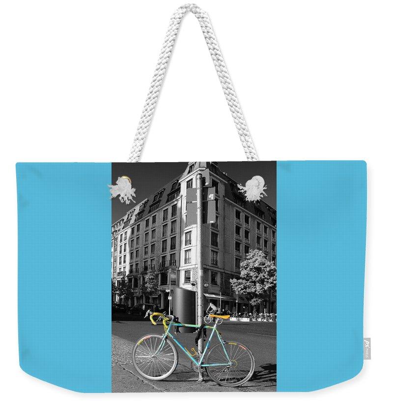 Biking Weekender Tote Bag featuring the photograph Berlin Street View With Bianchi Bike by Ben and Raisa Gertsberg