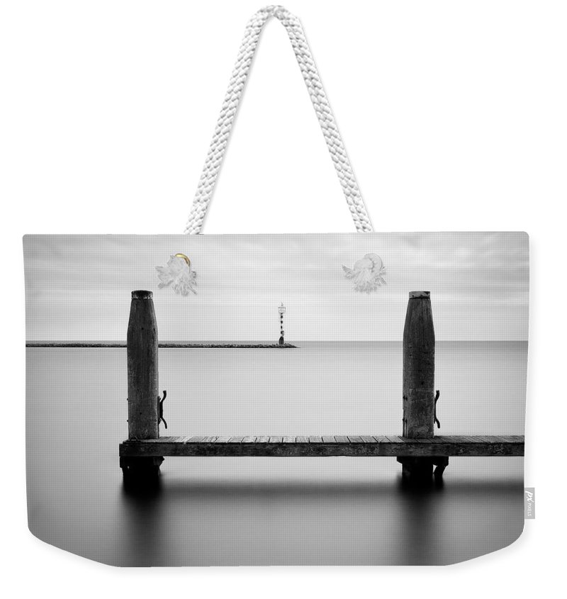 Boat Jetty Weekender Tote Bag featuring the photograph Beyond The Jetty by Dave Bowman