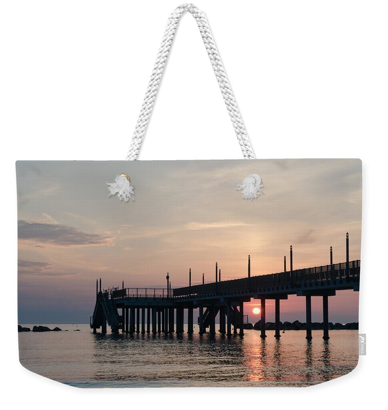 Staring At The Sun Weekender Tote Bag featuring the photograph Beyond The Last Horizon by Andrea Mazzocchetti