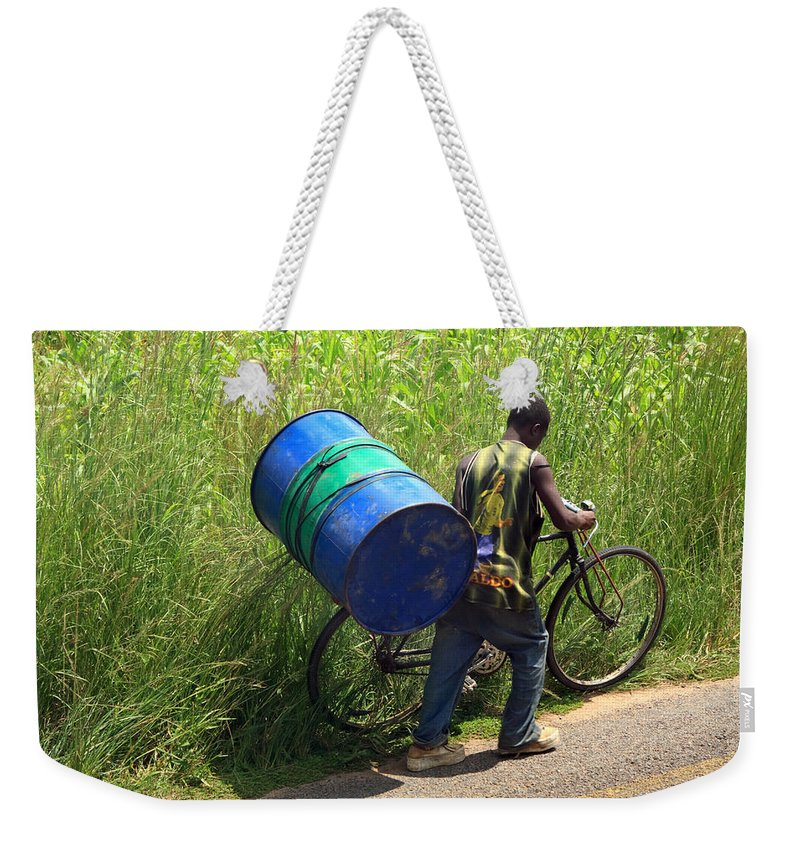 Africa Weekender Tote Bag featuring the photograph Bicycle Strain by Aidan Moran
