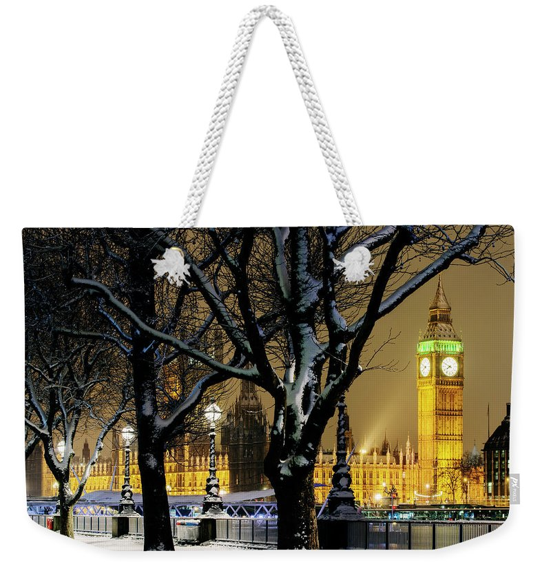 Tranquility Weekender Tote Bag featuring the photograph Big Ben And Houses Of Parliament In Snow by Shomos Uddin