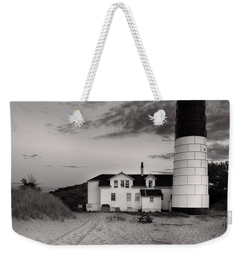 Lighthouse Weekender Tote Bag featuring the photograph Big Sable Point Lighthouse In Black And White by Sebastian Musial