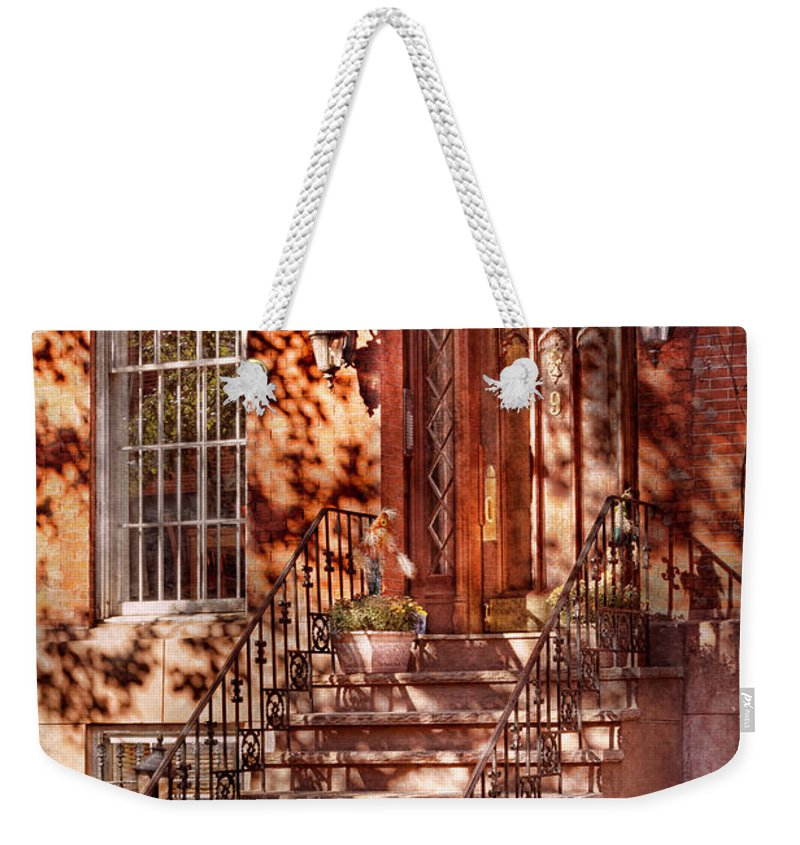 Savad Weekender Tote Bag featuring the photograph Bike - Ny - Greenwich Village - An Orange Bike by Mike Savad
