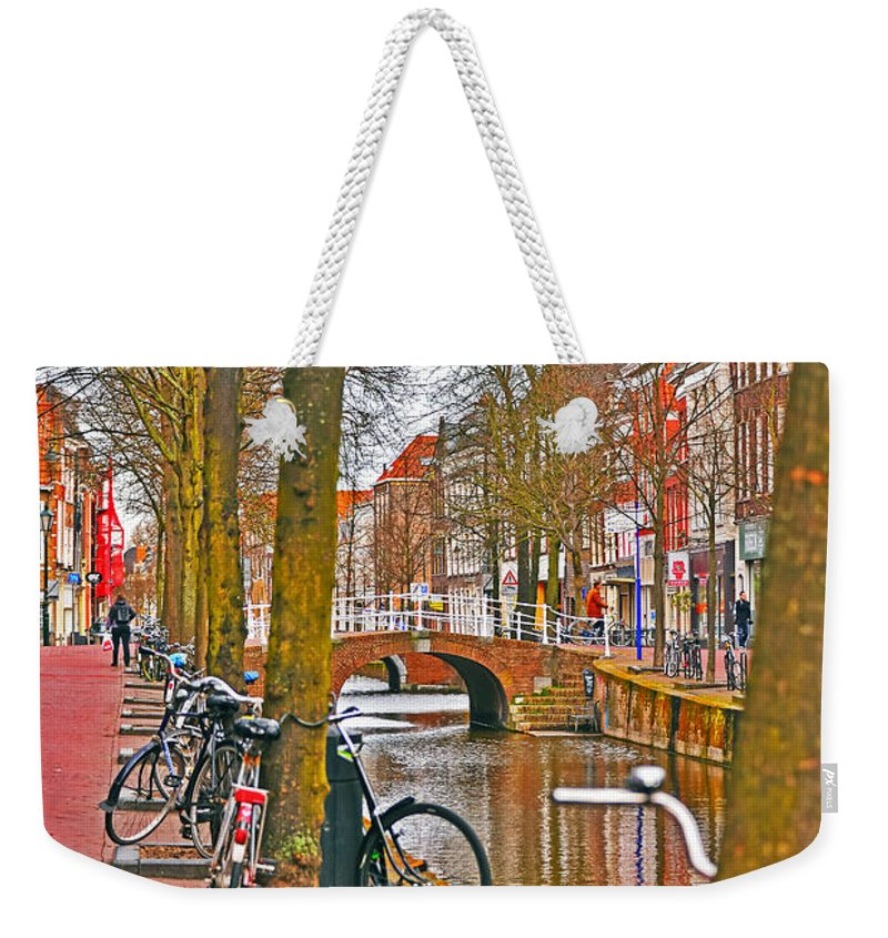Travel Weekender Tote Bag featuring the photograph Bikes And Canals by Elvis Vaughn