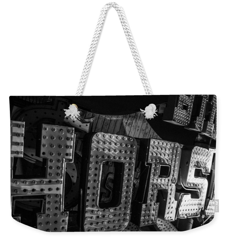 Las Vegas Weekender Tote Bag featuring the photograph Binion's Horsehoe by Angus Hooper Iii