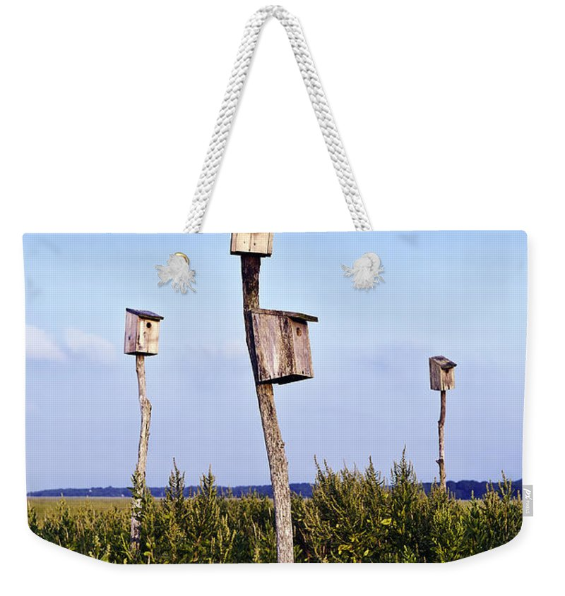 Cape Cod Weekender Tote Bag featuring the photograph Birdhouses In Salt Marsh. by John Greim