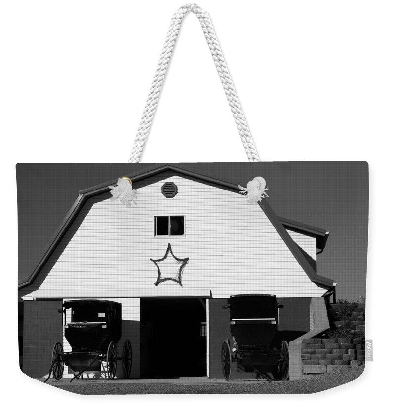 Black And White Amish Buggies And Barn Weekender Tote Bag featuring the photograph Black And White Amish Buggies And Barn by Dan Sproul