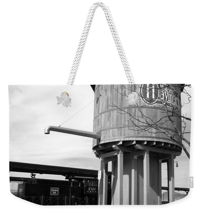 Black And White Weekender Tote Bag featuring the photograph Black And White Of A Water Tower by Paul Cannon