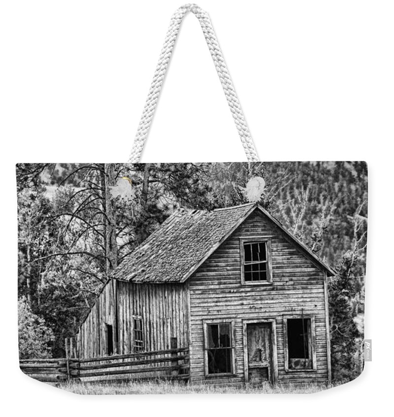 Farms Weekender Tote Bag featuring the photograph Black And White Old Merritt Farmhouse by Randy Harris