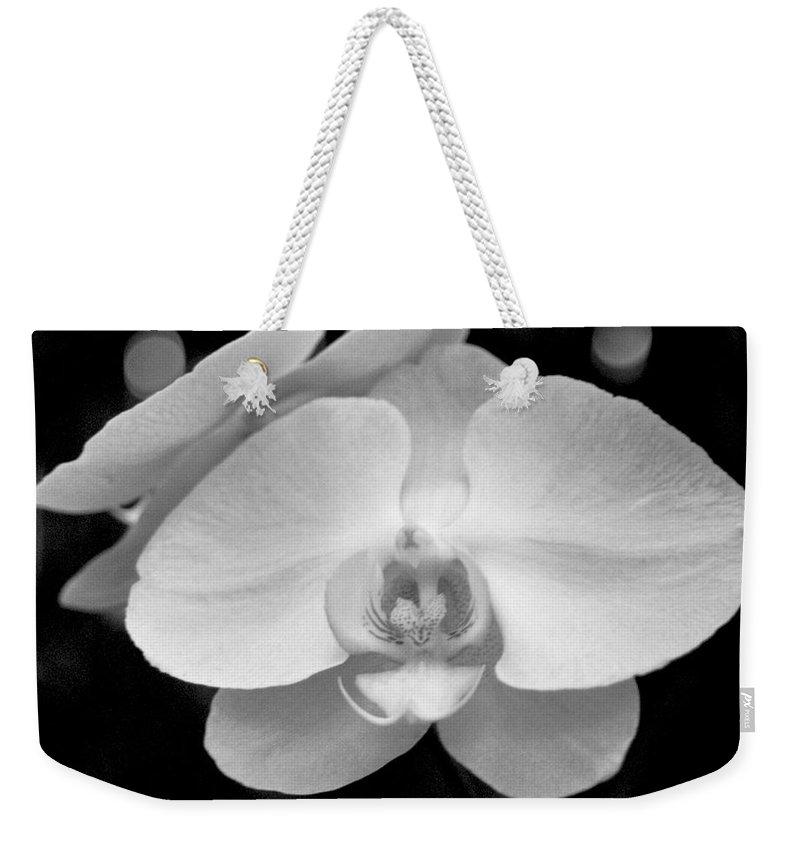 Floral Weekender Tote Bag featuring the photograph Black And White Orchid With Lights - Square by Heather Kirk