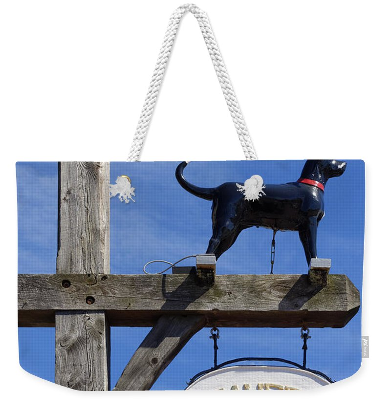 black Dog Weekender Tote Bag featuring the photograph Black Dog Tavern by John Greim