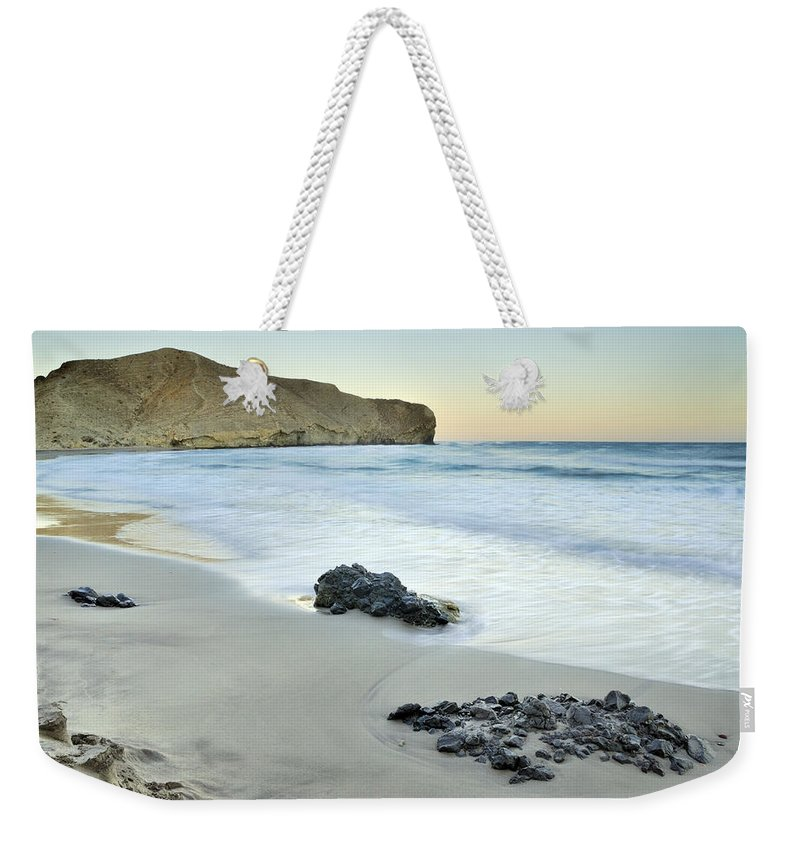 Seascape Weekender Tote Bag featuring the photograph Black Volcanic Rocks by Guido Montanes Castillo