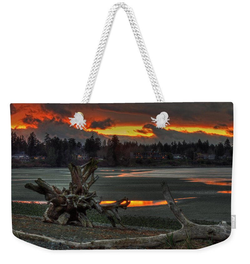 Sunset Weekender Tote Bag featuring the photograph Blazing Sunset by Randy Hall
