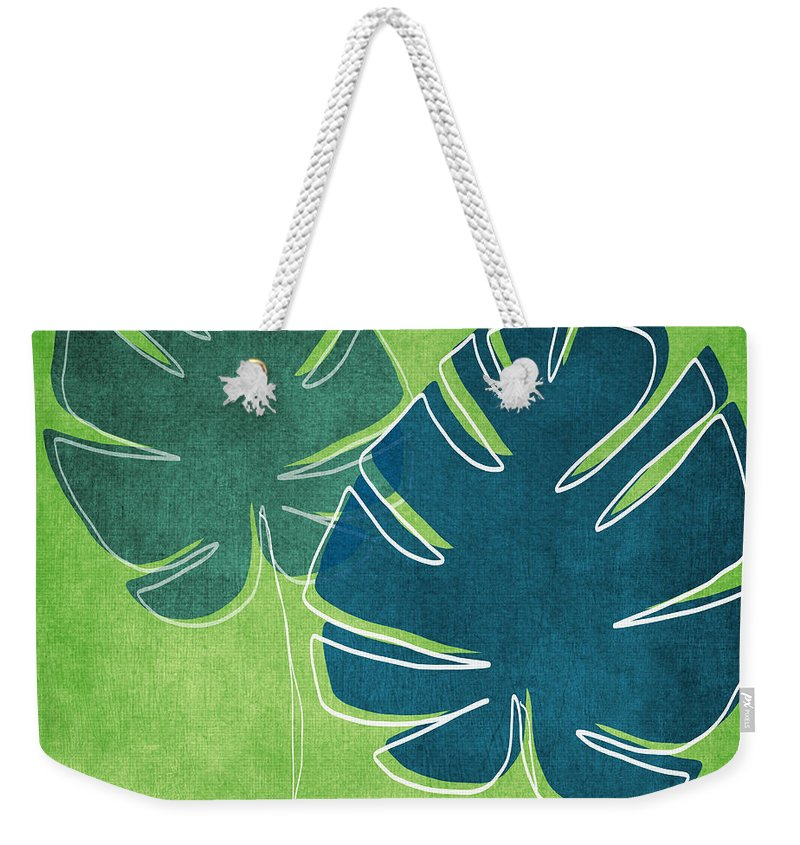 Palm Tree Weekender Tote Bag featuring the painting Blue and Green Palm Leaves by Linda Woods