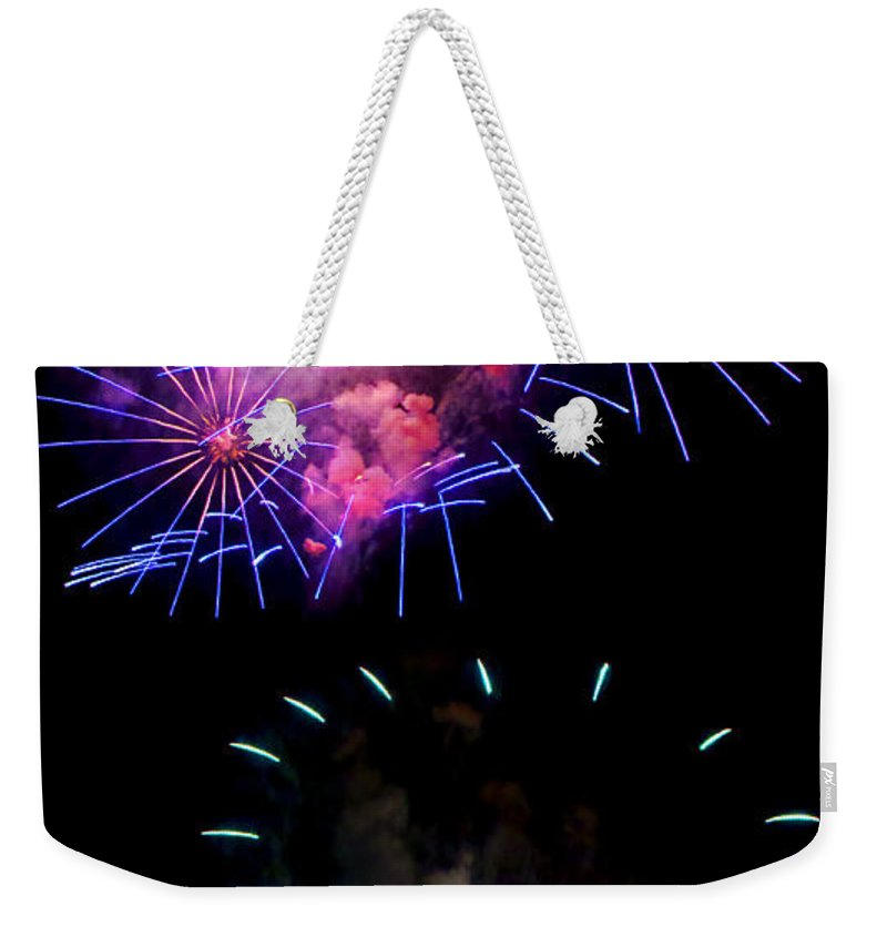 Fireworks Weekender Tote Bag featuring the photograph Blue And Red Firework Disks by Weston Westmoreland