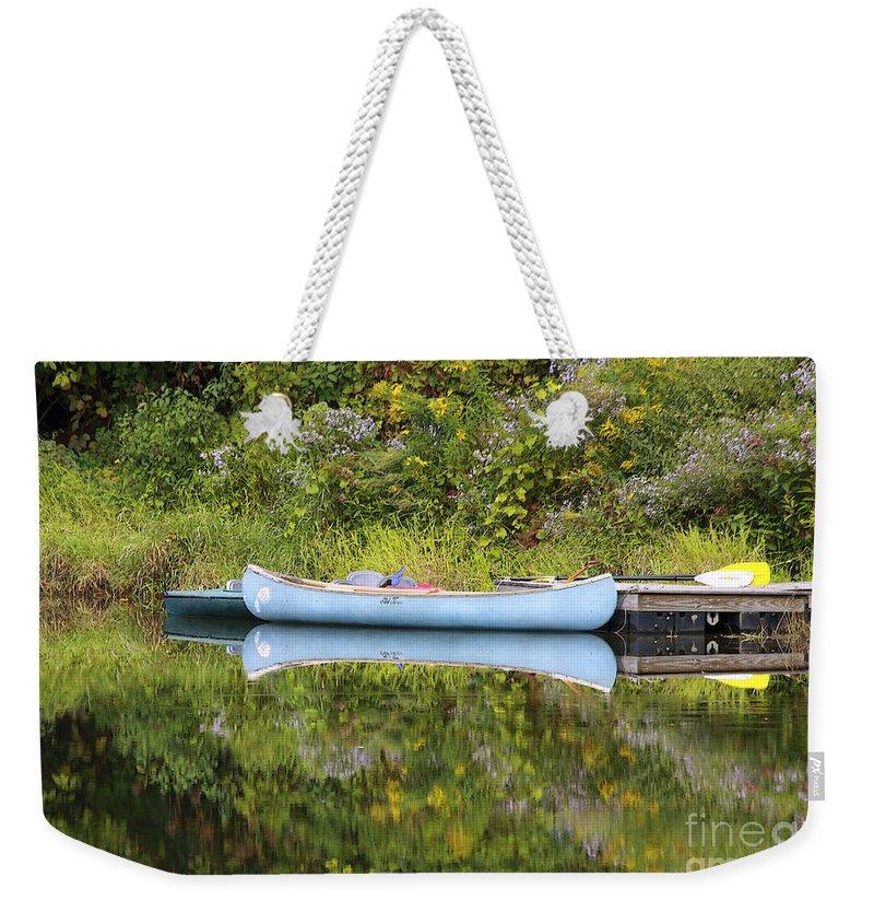 Pond Weekender Tote Bag featuring the photograph Blue Canoe by Deborah Benoit
