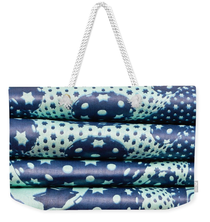 Africa Weekender Tote Bag featuring the photograph Blue Cloth by Tom Gowanlock