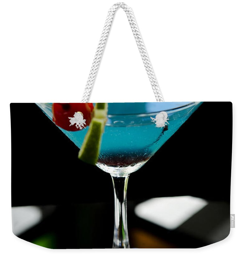 Blue Weekender Tote Bag featuring the photograph Blue Cocktail With Cherry And Lime by Jacek Malipan