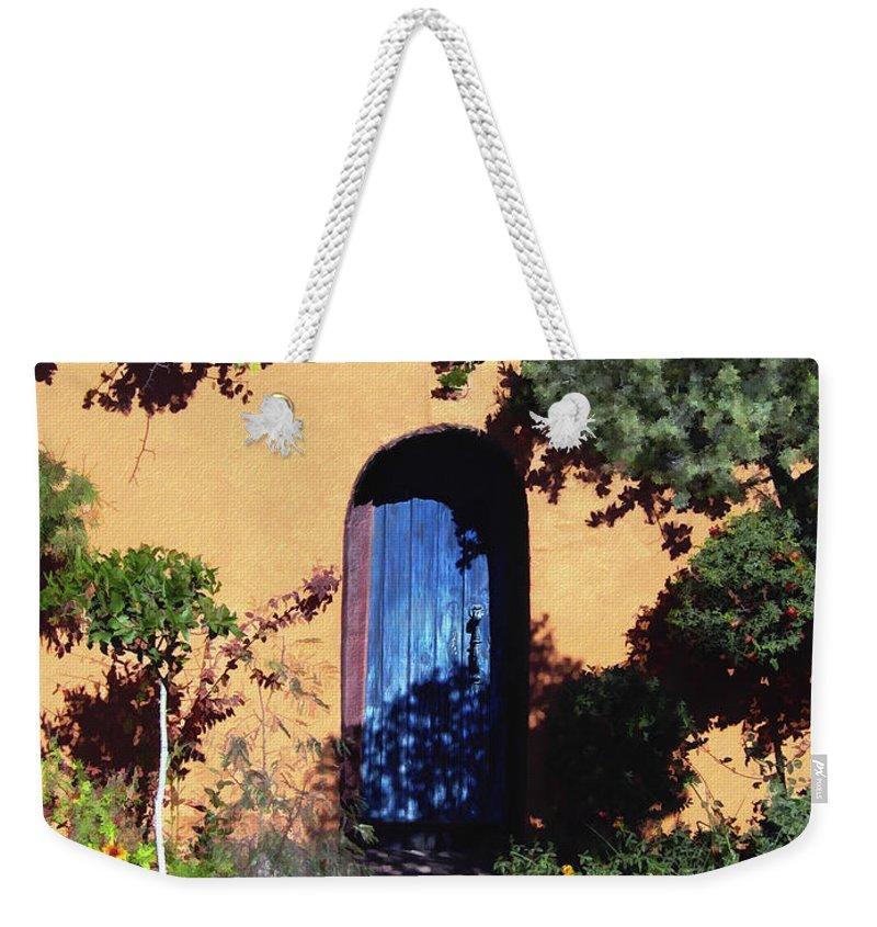 Blue Door Weekender Tote Bag featuring the photograph Blue Door At Old Mesilla by Kurt Van Wagner