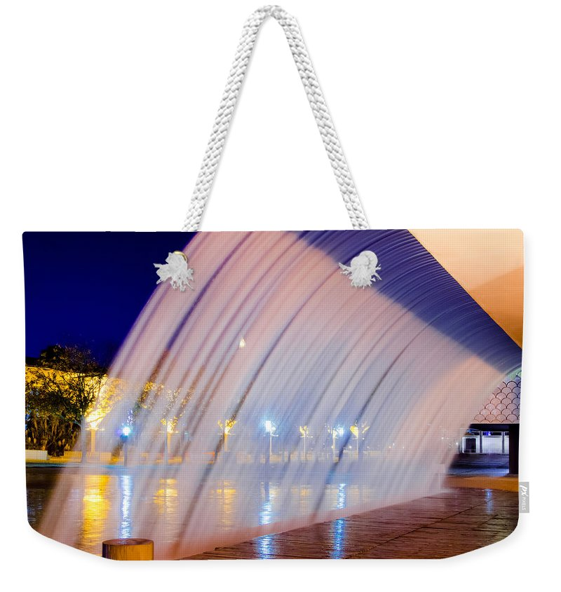 Blue Weekender Tote Bag featuring the photograph Blue Fountain At Night by Alexandre Martins