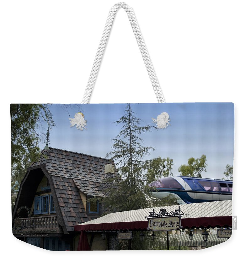 Rail Weekender Tote Bag featuring the photograph Blue Monorail Fairytale Arts Disneyland by Thomas Woolworth