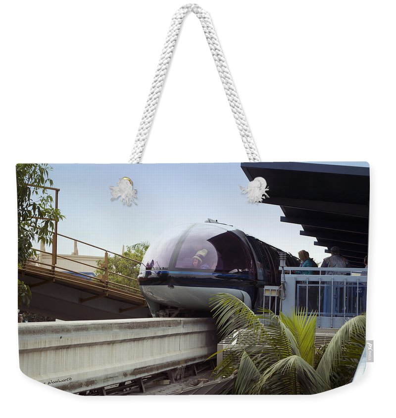 Rail Weekender Tote Bag featuring the photograph Blue Monorail In The Station Disneyland 01 by Thomas Woolworth