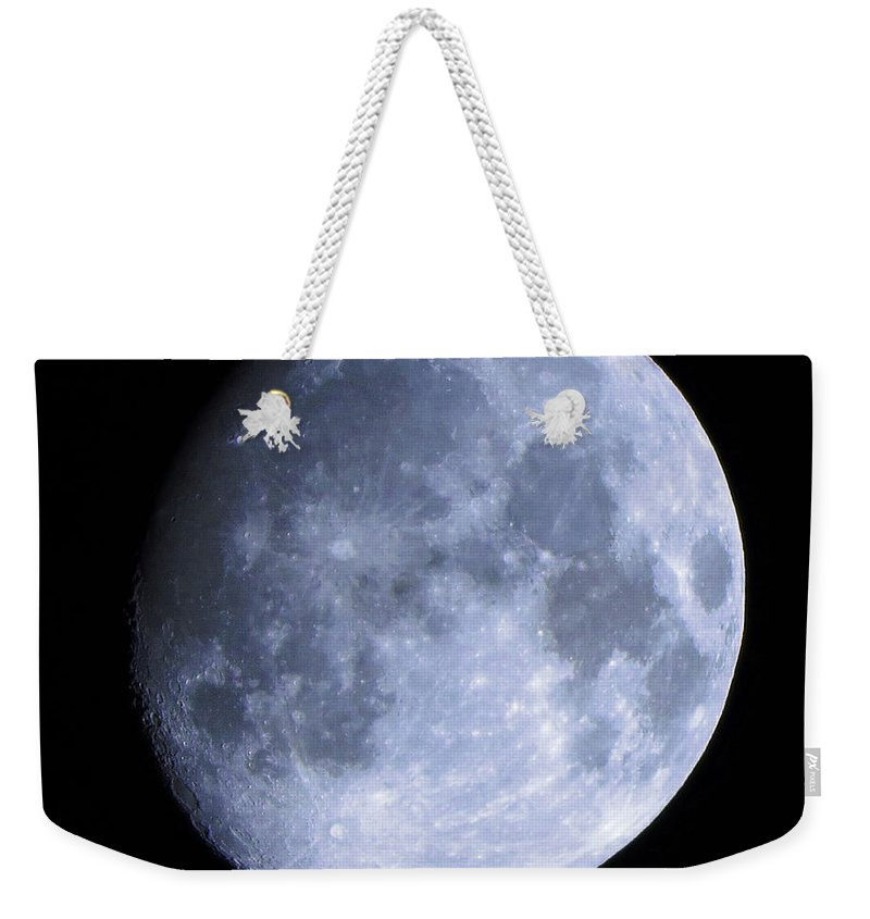 Colored Weekender Tote Bag featuring the photograph Blue Moon by Aaron Martens