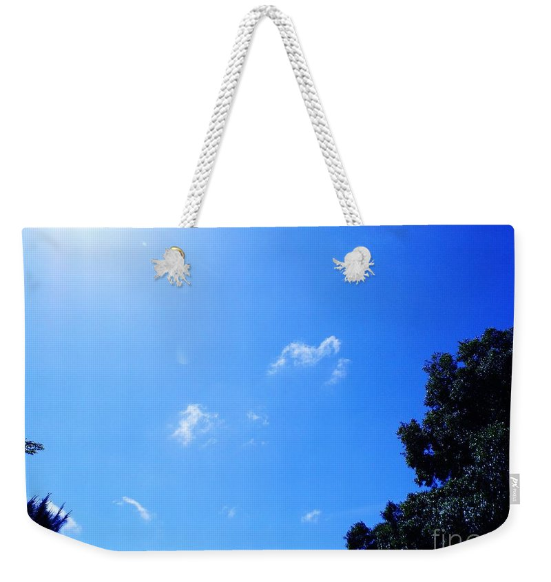Clouds Weekender Tote Bag featuring the photograph Blue Sky And Sunshine by D Hackett