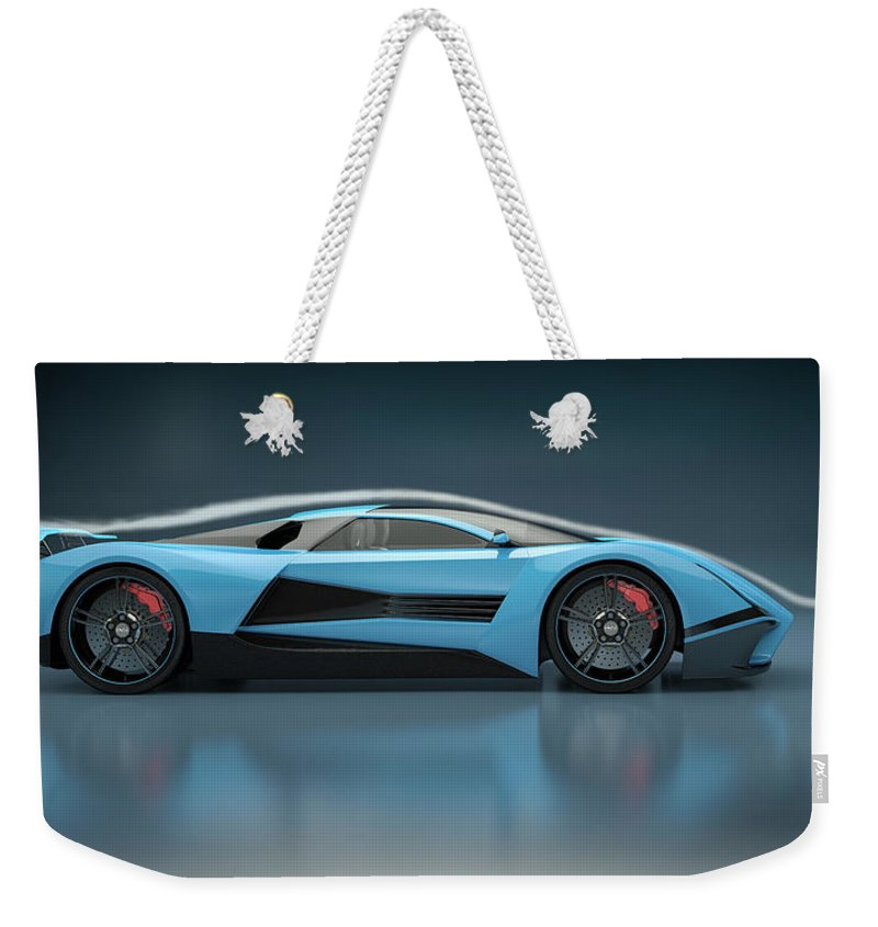 Aerodynamic Weekender Tote Bag featuring the photograph Blue Sports Car In A Wind Tunnel by Mevans