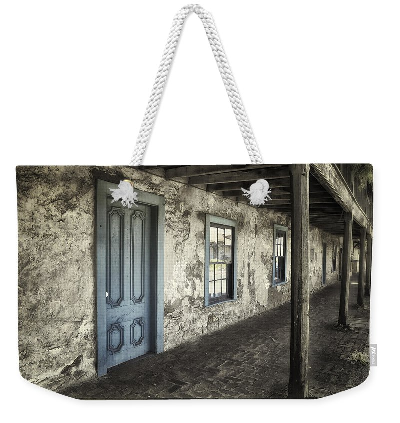 Age Weekender Tote Bag featuring the photograph Blue Wing Inn by Joan Carroll