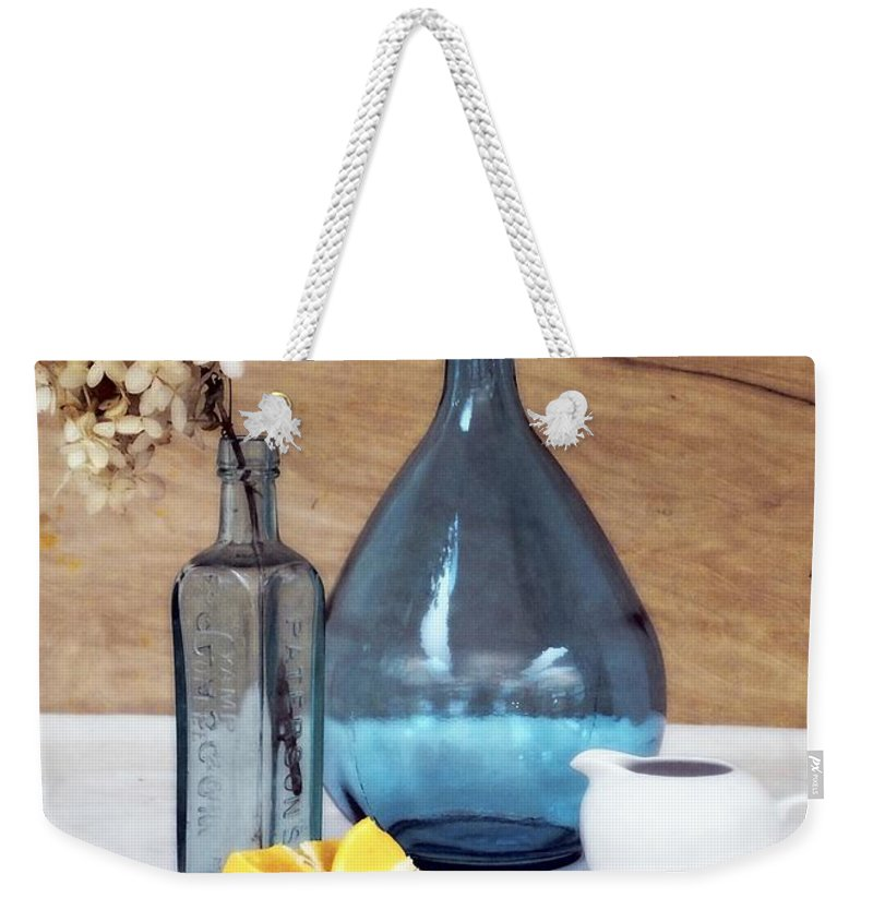 Setting Weekender Tote Bag featuring the photograph Blues And Oranges by Deborah Crew-Johnson