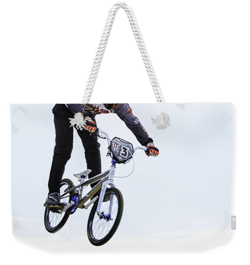 Bike Weekender Tote Bag featuring the photograph Bmx Racer by Fran Gallogly