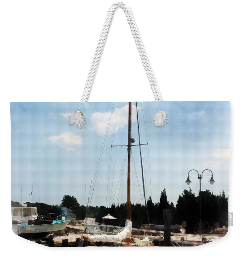 Cabin Cruiser Weekender Tote Bag featuring the photograph Boat - Docked Cabin Cruiser by Susan Savad