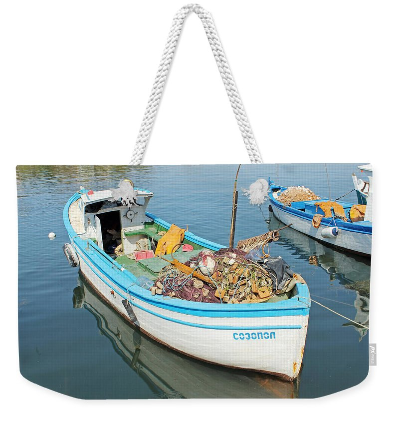 Sozopol Harbour Weekender Tote Bag featuring the photograph Boat Reflected In Sozopol Harbour by Tony Murtagh
