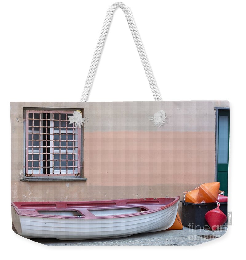 Boat Weekender Tote Bag featuring the photograph Boat Under A Window by Mats Silvan