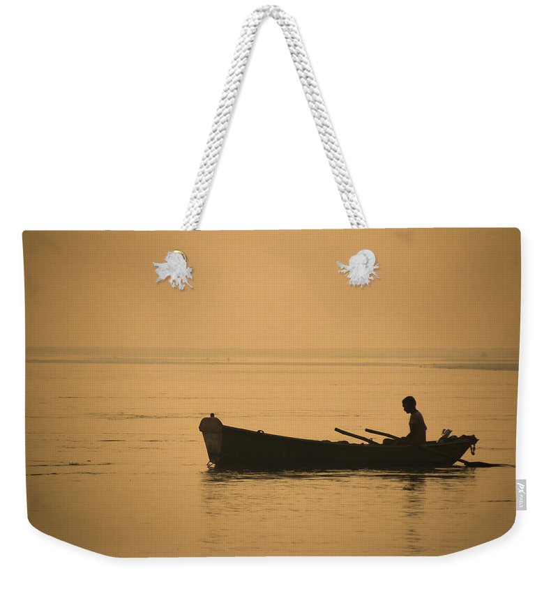 Allahabad Weekender Tote Bag featuring the photograph Boatman by Gaurav Singh