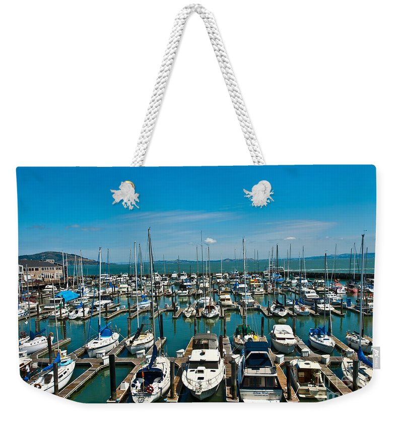 Boats Weekender Tote Bag featuring the photograph Boats At Bay by Anthony Sacco