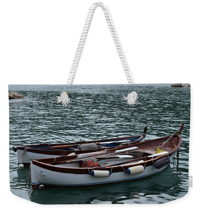Boat Weekender Tote Bag featuring the photograph Boats At Rest by Dany Lison