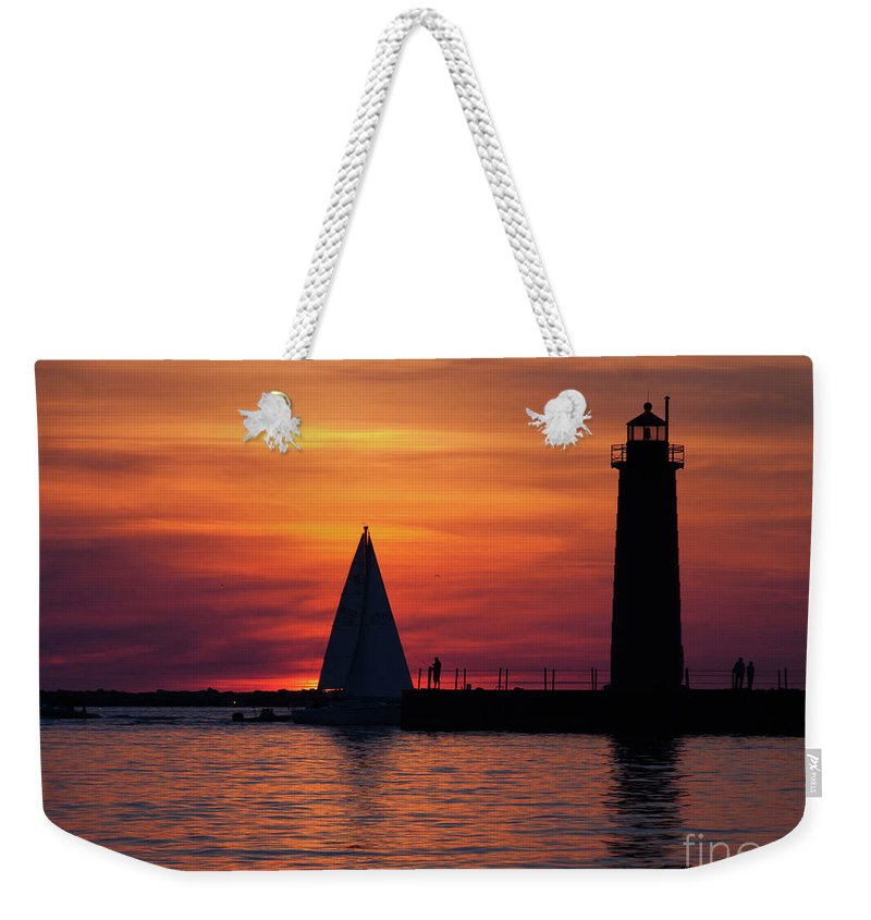 Nautical Weekender Tote Bag featuring the photograph Boats Entering The Channel At The Muskegon Lighthouse by John Harmon