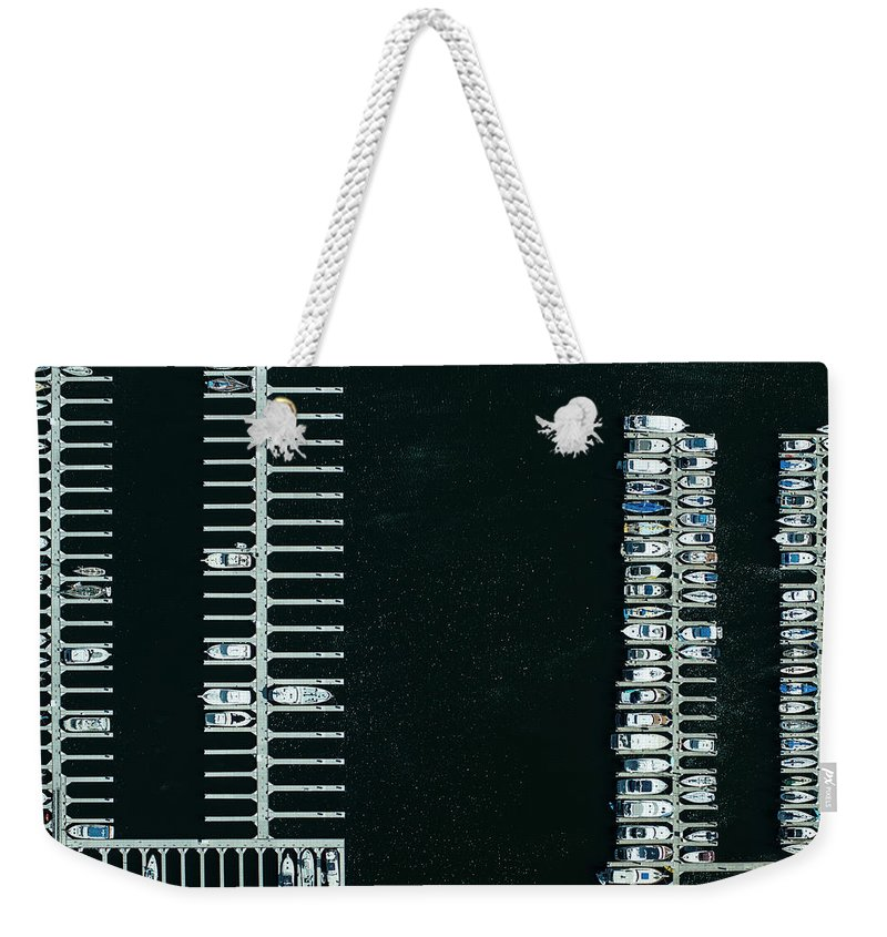 Tranquility Weekender Tote Bag featuring the photograph Boats In The Harbour by Michael H